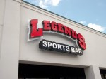 Legends Sports Bar lighted channel letters on a backplate in Highland Village, TX by Signs Manufacturing, Dallas, Texas.